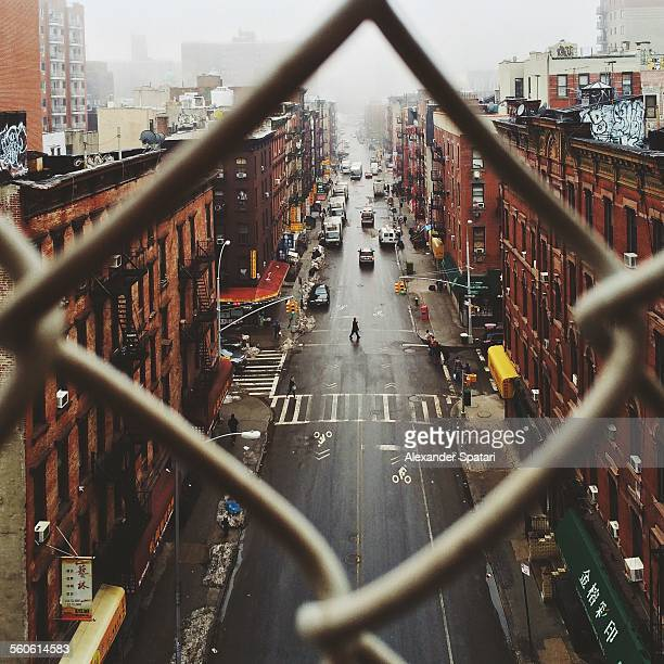 Chinatown seen through fence on a foggy day, NYC