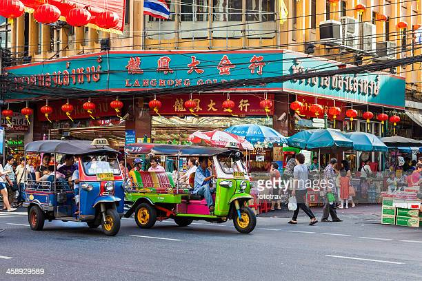 chinatown street life in bangkok - auto rickshaw stock pictures, royalty-free photos & images