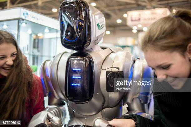 ChinaUkraine Scientific Exhibition of Technologies and Innovations is held in Kiev Ukraine on November 21 2017 A man wearing an exoskeleton robotic...