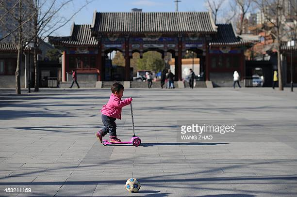 ChinaUShealthsurrogacyFEATURE by FELICIA A child plays at a park in Beijing on November 26 2013 For decades China has been a top destination for...