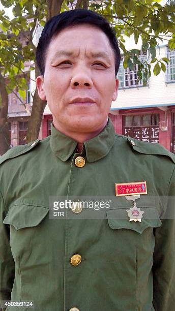 ChinaVietnammilitaryprotestFEATURE This undated mobile phone picture shows former Chinese Vietnam veteran soldier Teng Xingqiu in military uniform...