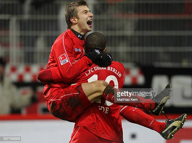 Chinedu Ede of Berlin jubilates with team mate Paul Thomik after scoring the fourth goal during the Second Bundesliga match between 1.FC Union Berlin...