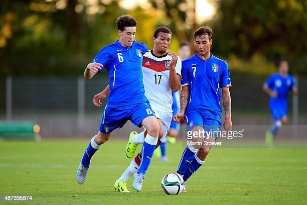 Chinedu Ekene of U17 Germany challenges Alessandro Bastoni and Edoardo Bianchi of U17 Italy during the match between U17 Germany v U17 Italy at...