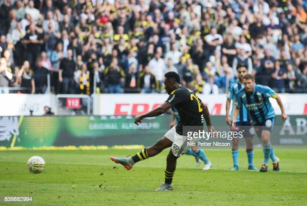 Chinedu Obasi of AIK scores the opening goal to 10 on a penalty kick during the Allsvenskan match between AIK and Djurgardens IF at Friends arena on...