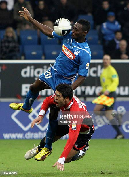 Chinedu Obasi of Hoffenheim and Karim Haggui of Hannover battle for the ball during the Bundesliga match between 1899 Hoffenheim and Hannover 96 at...