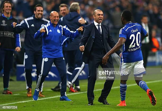 Chinedu Obasi of Schalke celebrates scoring their first goal Roberto Di Matteo the manager of Schalke during the UEFA Champions League Group G match...