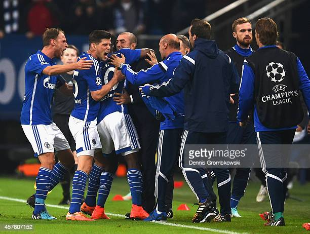 Chinedu Obasi of Schalke celebrates scoring their first goal with team mates and Roberto Di Matteo the manager of Schalke during the UEFA Champions...