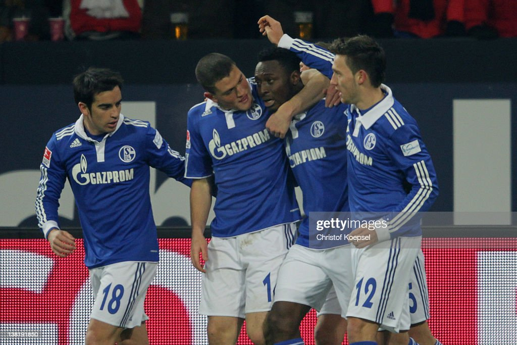 Chinedu Obasi (2nd R) of Schalke celebrates the first goal with Jose Manuel Jurado (L), Kyriakos Papadopoulos (2nd L) and Marco Hoeger (R) during the Bundesliga match between FC Schalke 04 and FSV Mainz 05 at Veltins Arena on February 4, 2012 in Gelsenkirchen, Germany.