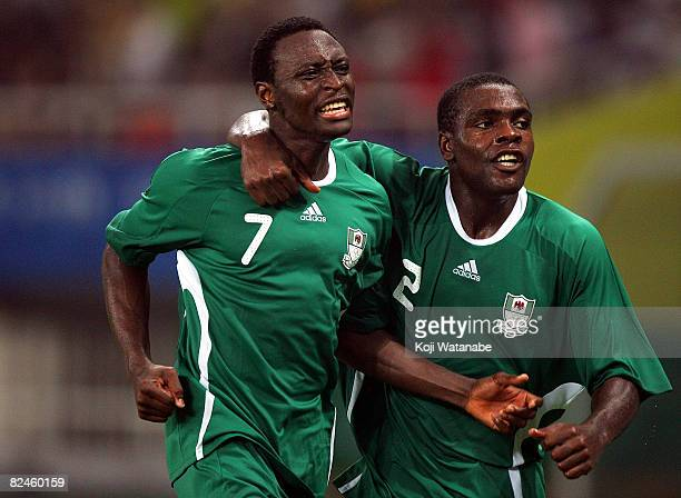 Chinedu Ogbuke Obasi of Nigeria celebrates the second goal with teammate Chibuzor Okonkwo during the Men's Semi Final match between Nigeria and...