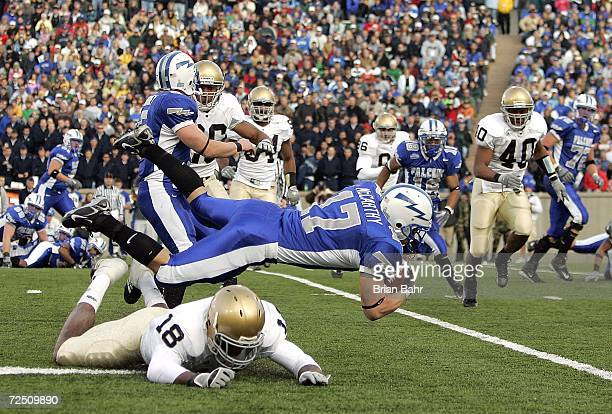 Chinedum Ndukwe of the Notre Dame Fighting Irish trips up halfback Kip McCarthy of the Air Force Falcons in the third quarter on November 11 2006 at...