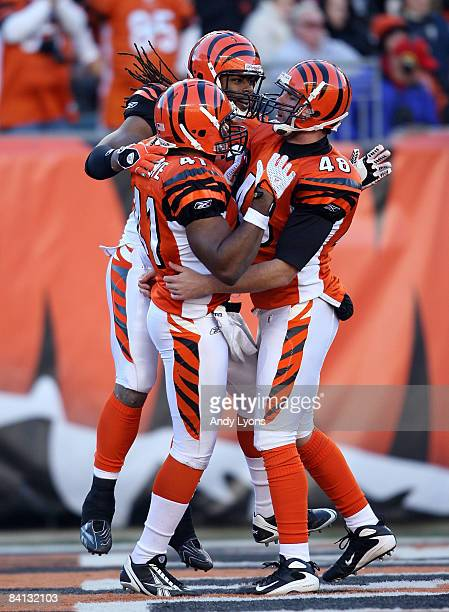 Chinedum Ndukwe Rashad Jeanty and Brad St Louis of the Cincinnati Bengals celebrate a defensive stop during the NFL game against the Kansas City...