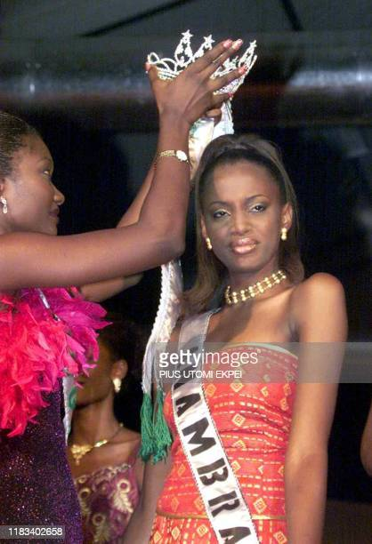 Chinenye Ochuba eighteenyearold receptionist is crowned The most beautiful girl in Nigeria by her predecessor Anne Suinner 02 March 2002 in Lagos...