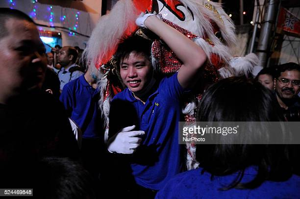 Chines origin boy playing with his dragon mask during the Chinese New Year celebration 2015 in Kolkata, India on February 18, 2015. Chinese New Year...