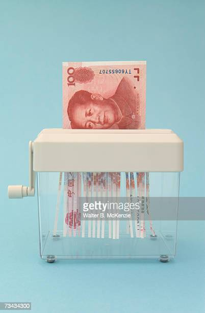 Chinese 100 Yuan banknote in shredder