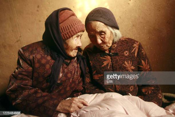 Chinese 104yearold twins Cao Daqiao and Cao Xiaoqiao talk at home in Weifang east China's Shandong province on November 29 2009 According to the...