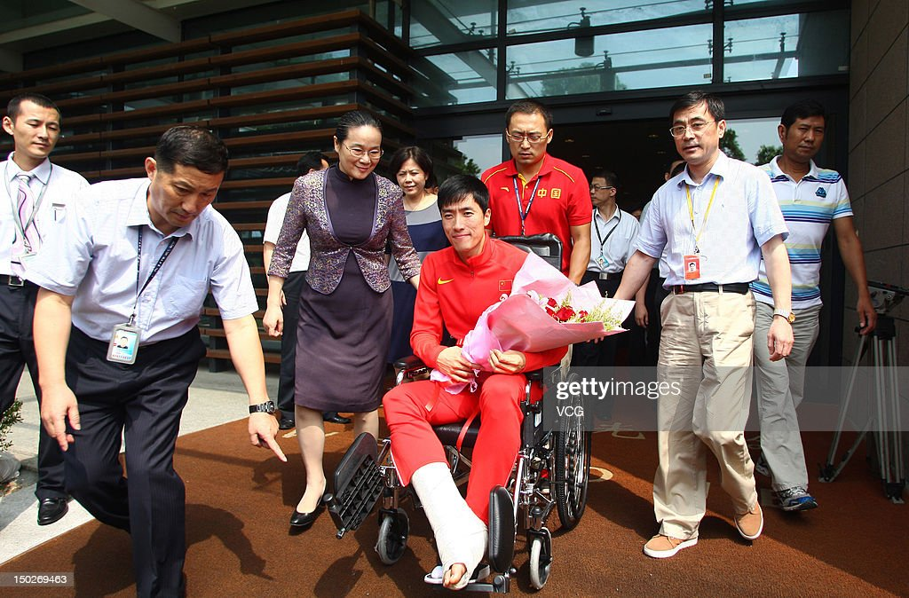 Chinese 110 meter hurdler Liu Xiang arrives in Shanghai after surgery in London, on August 14, 2012 in Shanghai, China. Liu Xiang fell over the first hurdle in his 110 metre hurdle heat, injuring his achilles tendon during the London 2012 Olympic Games.