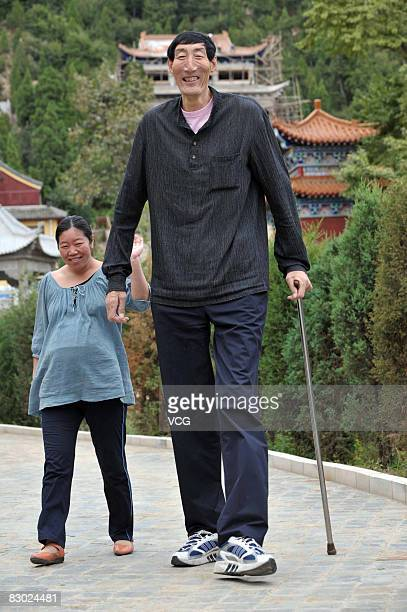 Chinese 236m tall man Bao Xishun is seen walking with his wife Xia Shujian in Zenrinji on September 26 2008 where they have their house in Zunhua...