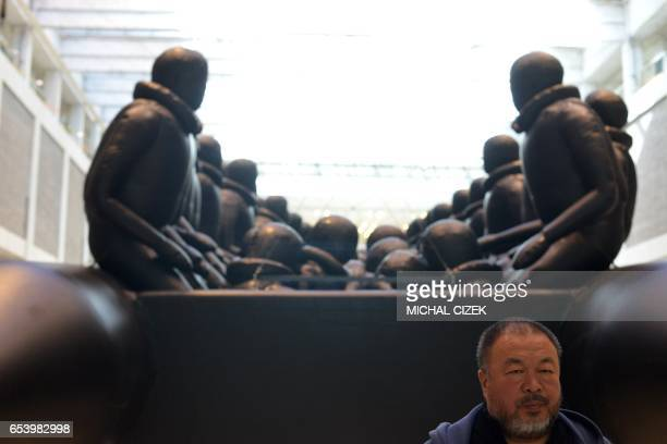 CORRECTION Chinese activist and artist Ai Weiwei poses for photographer with his so far biggest work of art a giant refugee boat entitled 'The Law of...