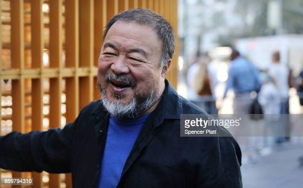 Chinese activist and artist Ai Weiwei stands in one of his new art installations in Central Park part of a series of works entitled 'Good Fences Make...