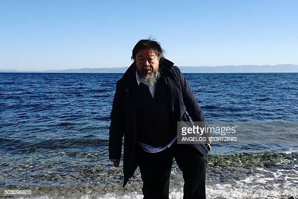 Chinese activist and artist Ai Weiwei walks on a beach near the town of Mytilene on the Greek island of Lesbos on January 1 2016 Chinese dissident...