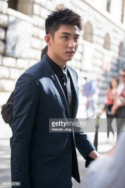 Chinese actor and model Huang Jingyu after Dior Homme during Paris Fashion Week Men's Spring/Summre 2019 on June 23 2018 in Paris France