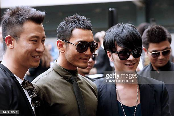 Chinese actor and singer Huang Xiaoming poses before the start of the men's springsummer 2013 fashion collection show of Belgian designer Kris Van...