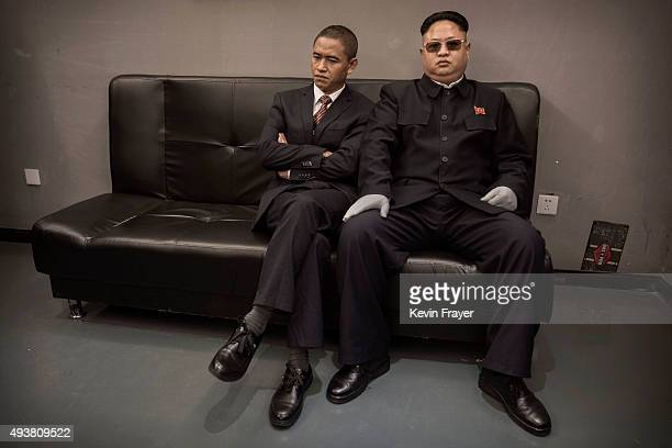 Chinese actor and United States President Barack Obama impersonator Xiao Jiguo and North Korean leader Kim Jung Un impersonator Jia Yongtang wait...