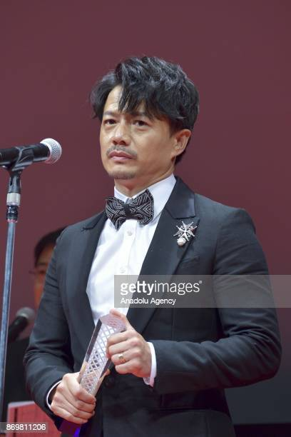 Chinese actor Duan Yihong winner the Best actor Award for the movie 'The Looming Storm' during the closing ceremony of the 30th Tokyo International...