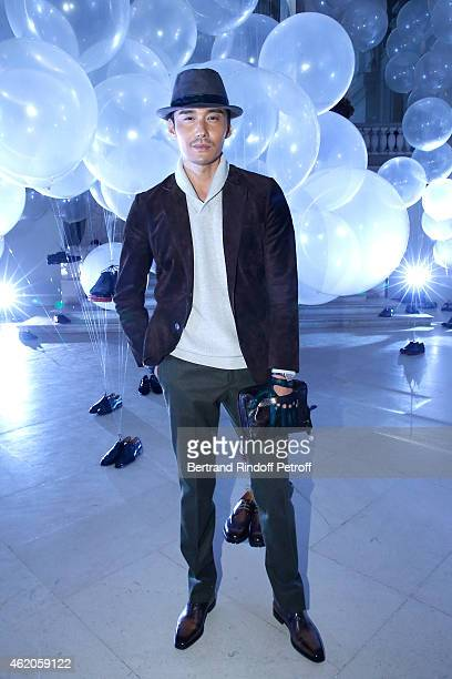 Chinese Actor Hu Bing attends the Berluti Menswear Fall/Winter 20152016 Show as part of Paris Fashion Week Held at Musee des Arts Decoratifs on...