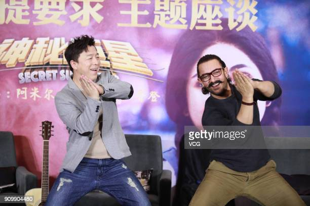 Chinese actor Huang Bo and Bollywood actor Aamir Khan attend 'Secret Superstar' press conference on January 24 2018 in Beijing China