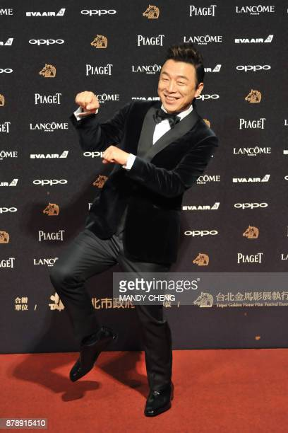 Chinese actor Huang Bo arrives on the red carpet to attend Taiwan's 54th Golden Horse film awards dubbed the Chinese 'Oscars' in Taipei on November...