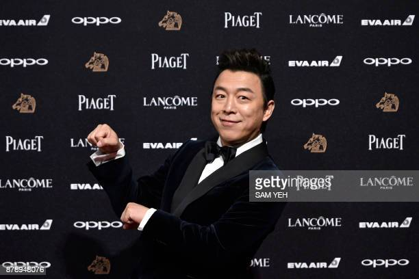 Chinese actor Huang Bo poses while attending Taiwan's 54th Golden Horse film awards dubbed the Chinese 'Oscars' in Taipei on November 25 2017 / AFP...