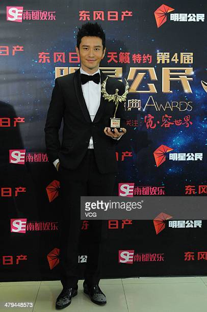Chinese actor Huang Xiaoming attends South Entertainment Weekly Awards on March 18 2014 in Beijing China