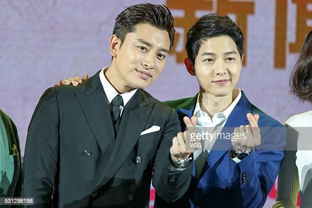 Chinese actor Jia Nailiang and South Korean actor Song Joongki meet fans on May 13 2016 in Beijing China
