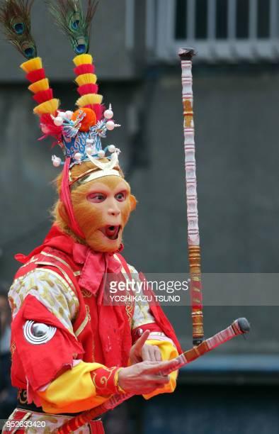 A Chinese actor performs Chinese opera to celebrate Chinese Lunar New Year at Yokohama Chinatown in Yokohama suburban Tokyo on January 29 2017 People...