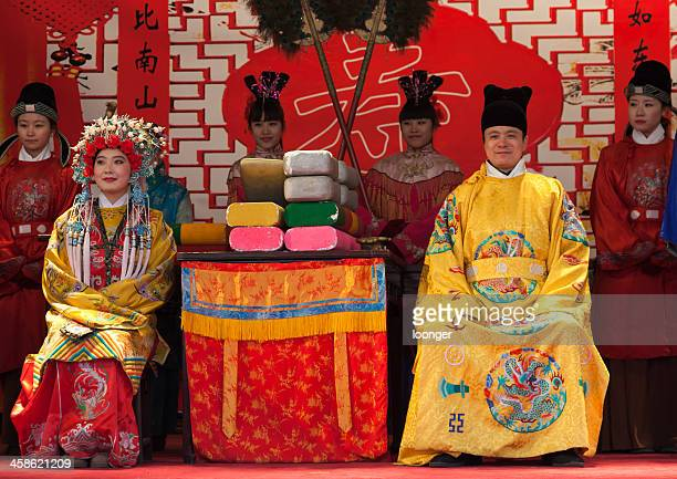 Chinese actor playing the Emperor and Empress on stage