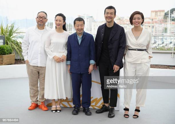 Chinese actor Zhang Yibai Chinese actress Zhao Tao Chinese director Jia ZhangKe and Chinese actor Liao Fan attend the photocall for 'Ash Is The...