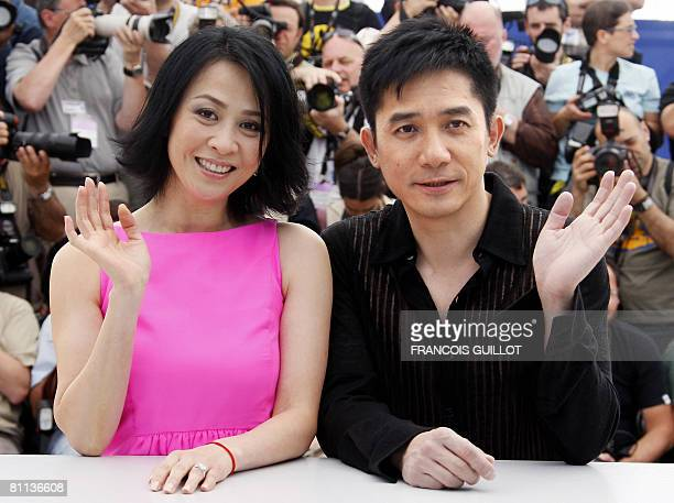 Chinese actors Carina Lau and Tony Leung wave as they pose during a photocall for Chinese director Wong Kar Wai's film 'Ashes of TimeRedux' at the...