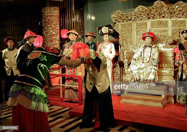 Chinese actors in imperial costumes depict the court of Emperor Qian Long during the 'royal banquet' which depicts the cuisines of the Qing Dynasty...