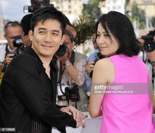 Chinese actors Tony Leung and Carina Lau pose during a photocall for Chinese director Wong Kar Wai's film 'Ashes of TimeRedux' at the 61st Cannes...