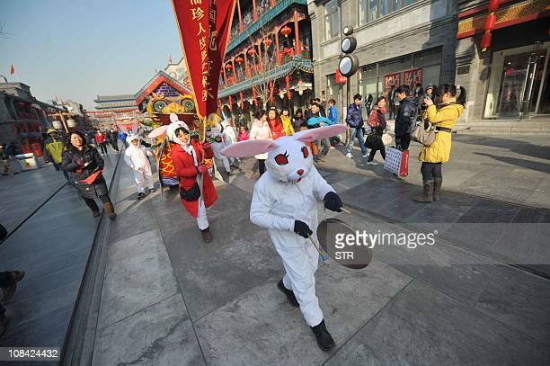 Chinese actors wearing bunny costumes perform during a folk art show for the Lunar New Year or the Year of Rabbit celebrations in Beijing on January...