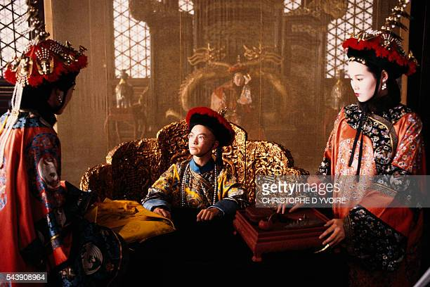 Chinese actors Wu Tao and Joan Chen on the set of The Last Emperor directed by Bernardo Bertolucci 1987