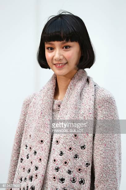 Chinese actress and model Angela Yuen poses before the Chanel 2017 Spring/Summer readytowear collection fashion show on October 4 2016 in Paris / AFP...