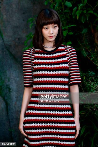 Chinese actress and model Angela Yuen poses during a photocall prior to the Chanel women's 2018 Spring/Summer readytowear collection fashion show in...