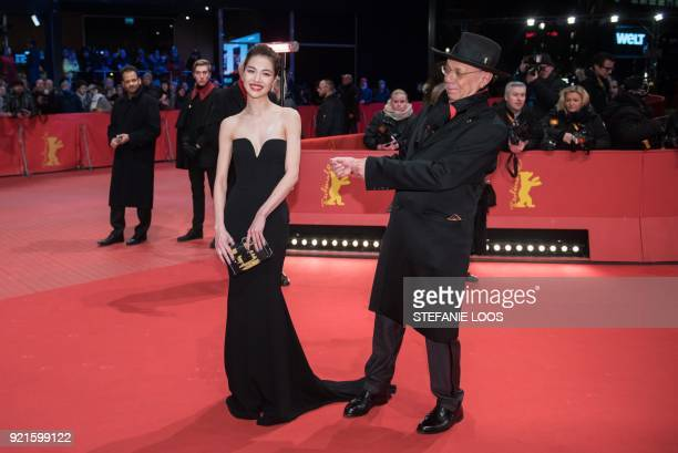 Chinese actress Elane Zhong poses next to Berlinale Director Dieter Kosslick on the red carpet as she arrives for the premiere of his film 'Don't...