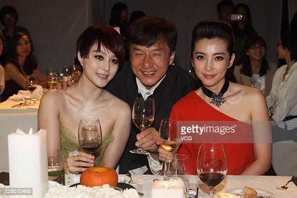 Chinese actress Fan Bingbing actor Jackie Chan and actress Li Bingbing attend the 2011 BAZAAR Charity Night at Park Hyatt Beijing Hotel on September...