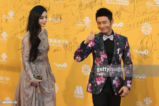 Chinese actress Fan Bingbing and actor Huang Xiaoming arrive for the red carpet of 4th Beijing International Film Festival at China's National Grand...