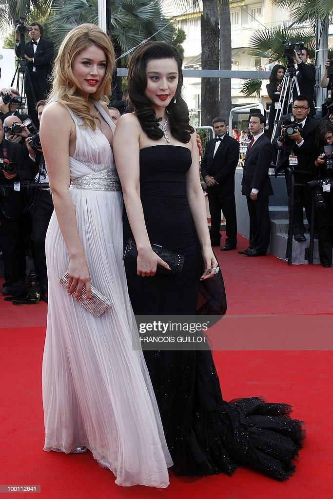 Chinese actress Fan Bingbing (R) and Dutch model Doutzen Kroes arrive for the screening of 'Des Hommes et des Dieux' (Of God and Men) presented in competition at the 63rd Cannes Film Festival on May 18, 2010 in Cannes.
