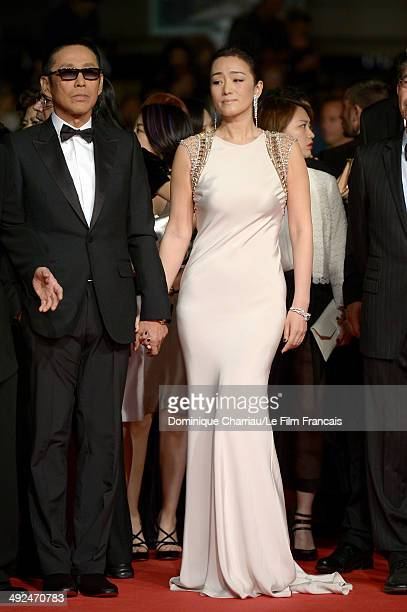 Chinese actress Gong Li and actor Chen Daoming attend the Coming Home Premiere during the 67th Annual Cannes Film Festival on May 20 2014 in Cannes...