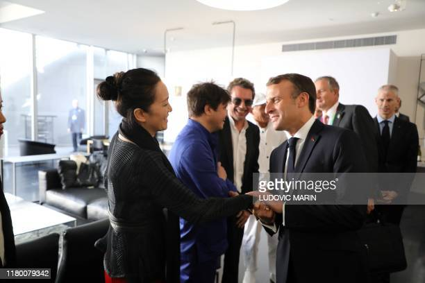 Chinese actress Gong li and her husband Jean-Michel Jarre meet with French President Emmanuel Macron before a lunch at the Pompidou Center in...